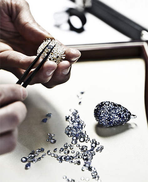 jeweler working on a colored stones jewelry piece