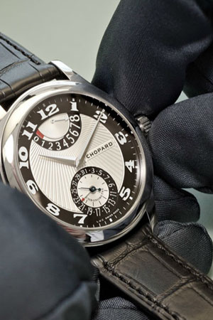 watchmaker setting time on watch to ten ten