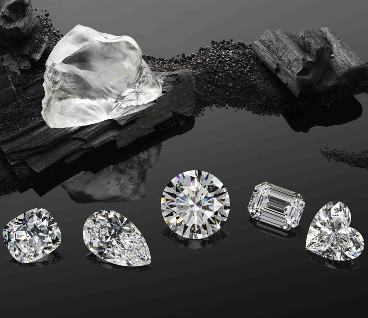 Image of queen of kalahari diamond next to 5 cut stones side by side on black carbon