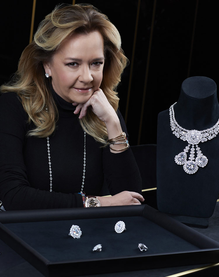 Image of Co-president Caroline Scheufele next to the full jewelry suite made from the queen of kalahari diamond