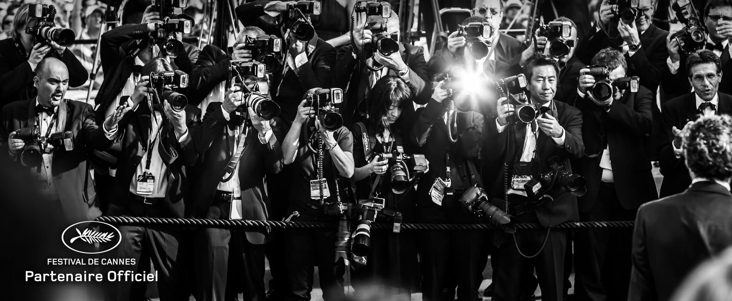 Image of photographers at the Cannes film festival with corresponding festival logo in black and white