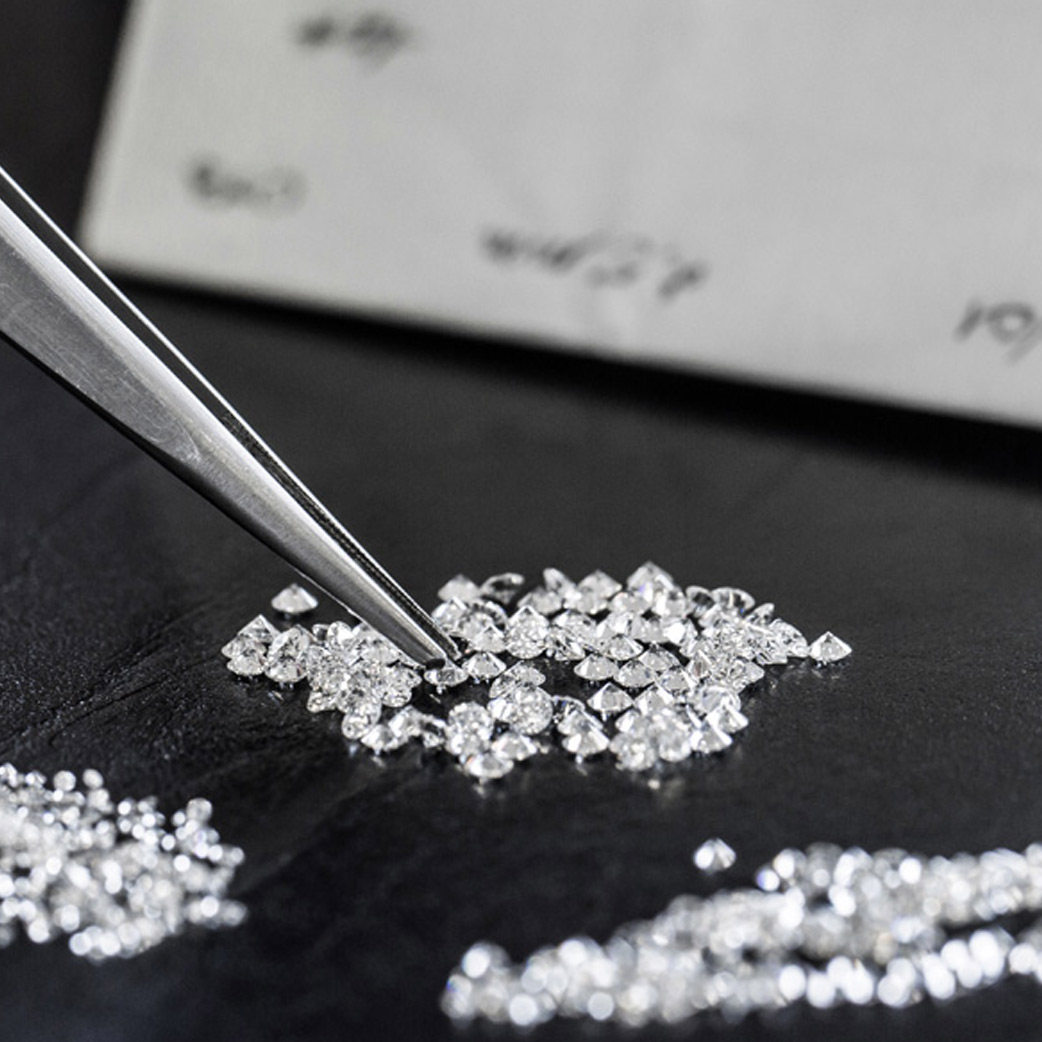 Close-up view of cut diamonds being sorted