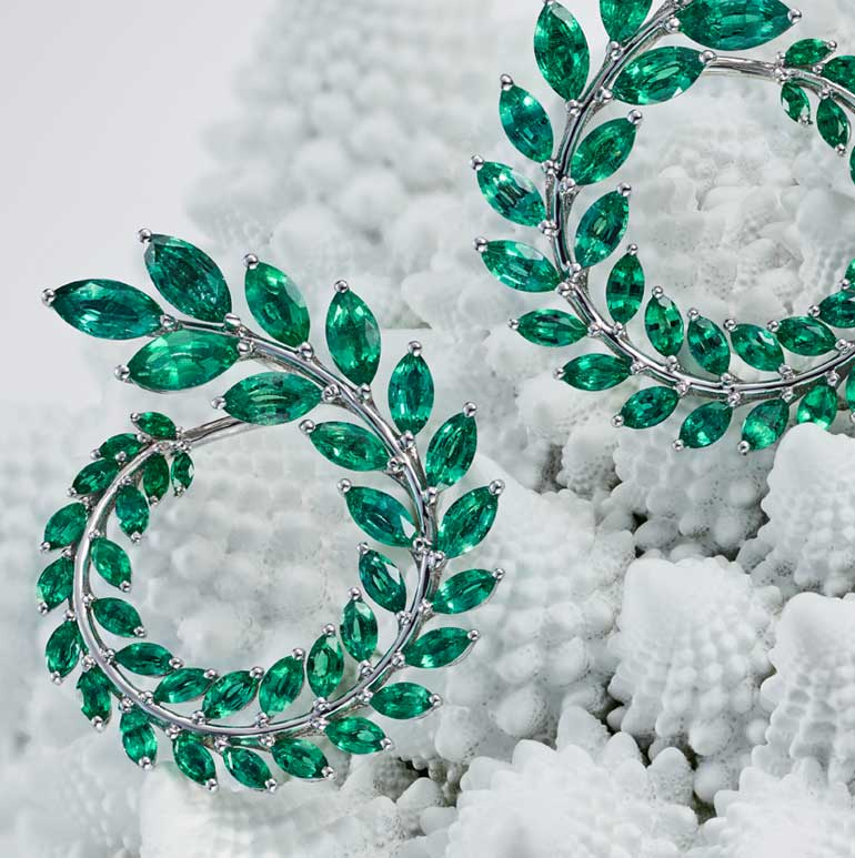 Close-up view of Green carpet collection earrings with emeralds
