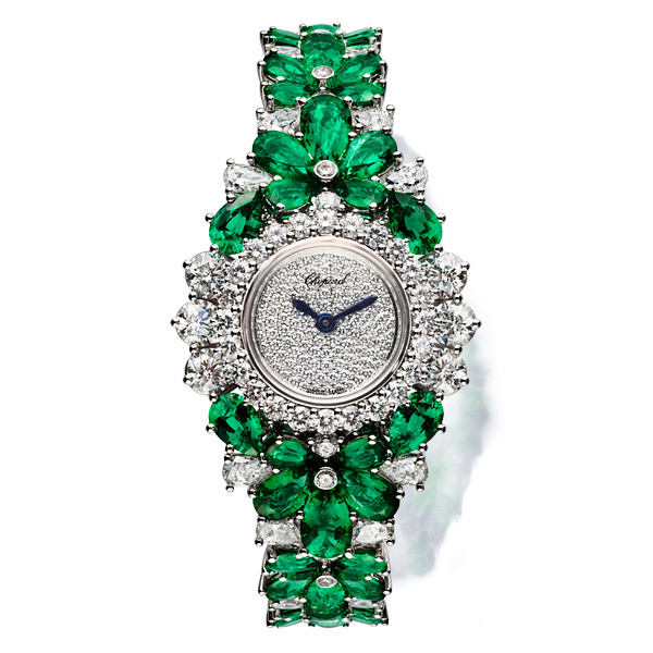 Image of an emerald and diamond set watch