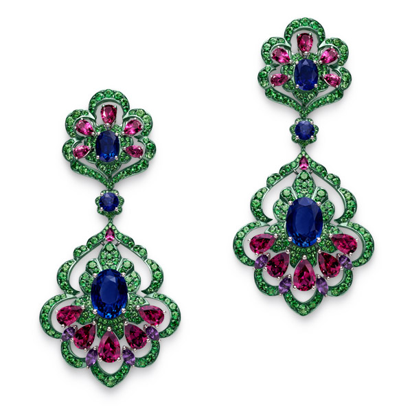 Close-up image of earrings with sapphires, amethysts, garnets, topaz and tsavorites