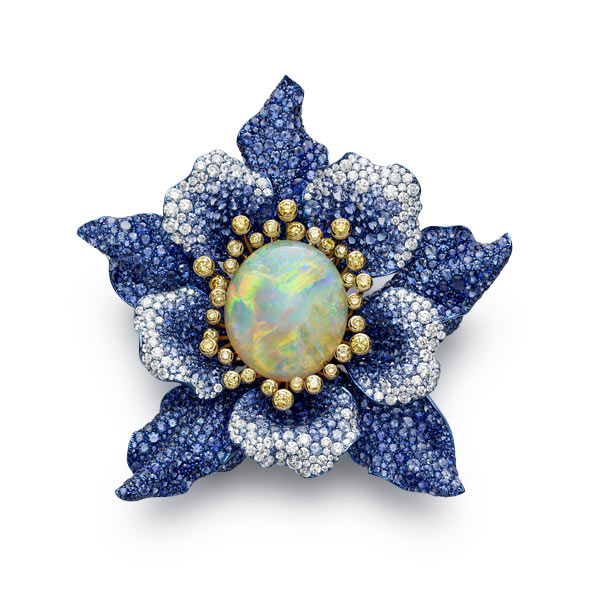 Close up image of a brooch set with opal, sapphires, yellow diamonds and diamonds