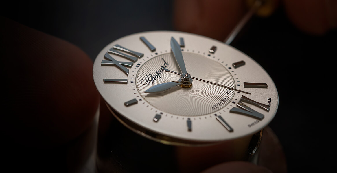 Image of Elaborate engravings being done on watch movement