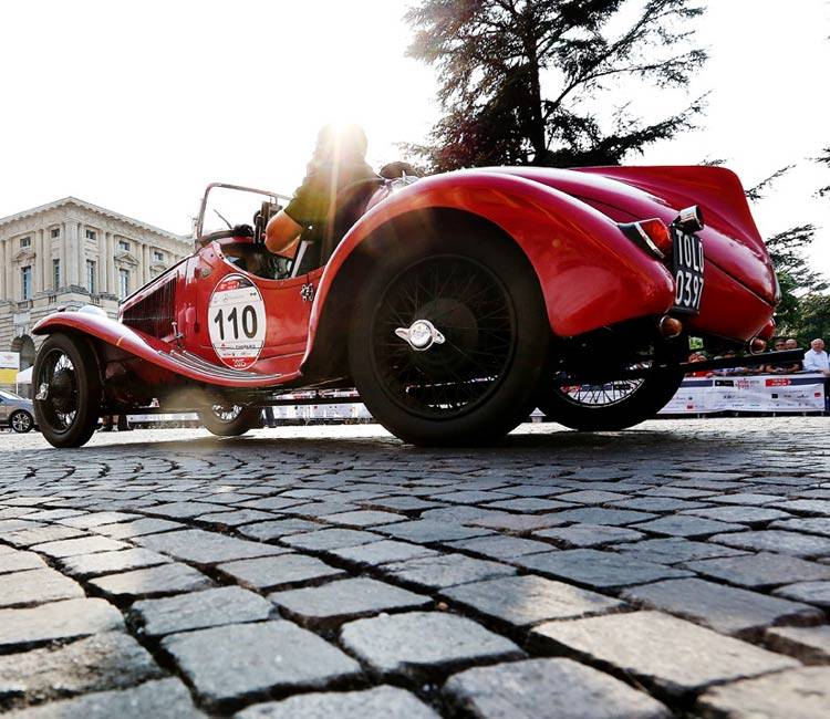 Image of a vintage car at the mille miglia race
