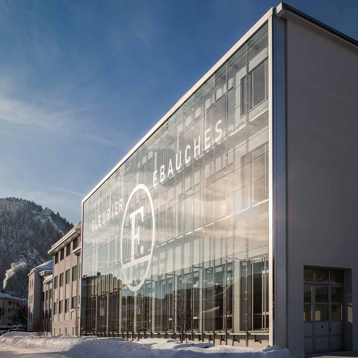 Front Facade view of one of the Chopard manufacture buildings in Fleurier Switzerland