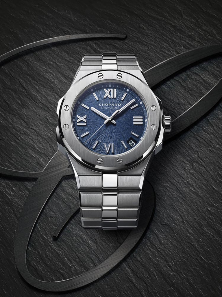 A silvery Alpine Eagle watch, with a deep blue dial reminiscing of  an eagle's iris