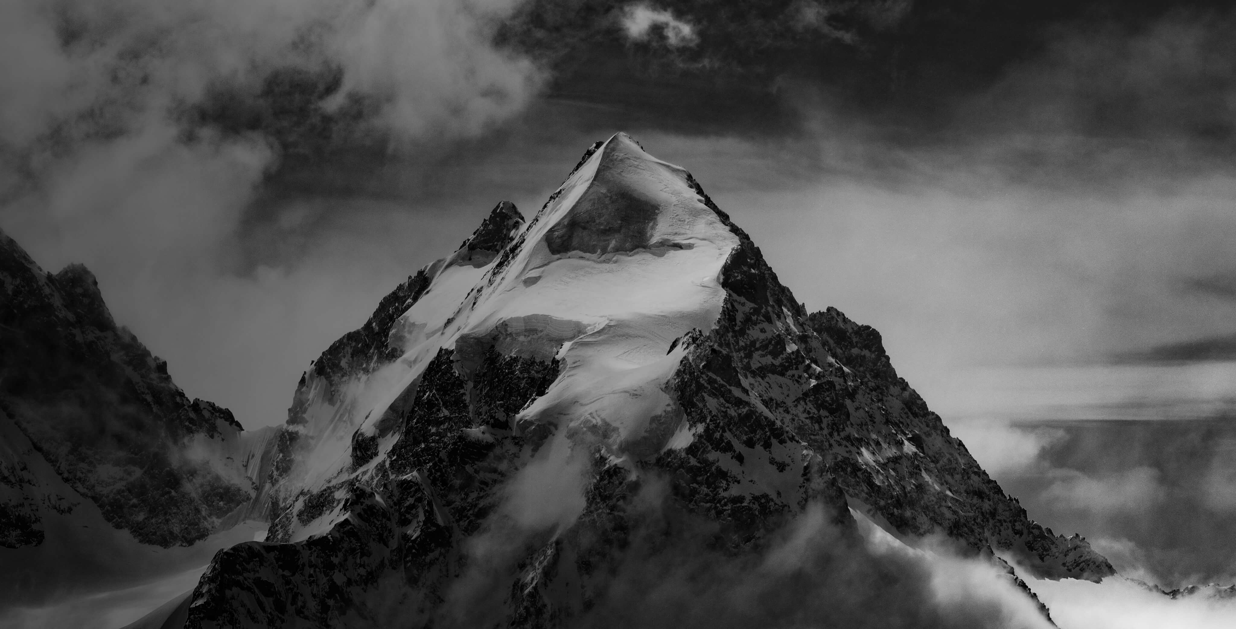 black and white background showing an alpine peak.