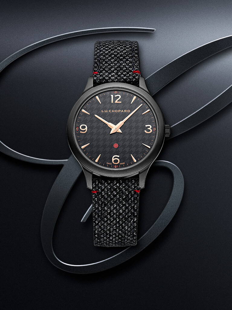 The Kiton Il Sarto watch, mostly black with subtle touches of red and gold in the dial