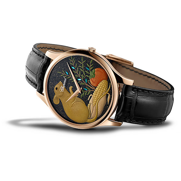 The rose gold L.U.C XP Urushi Year of the Rat timepiece, with a black leather strap and a dial with a rat sitting on corn.