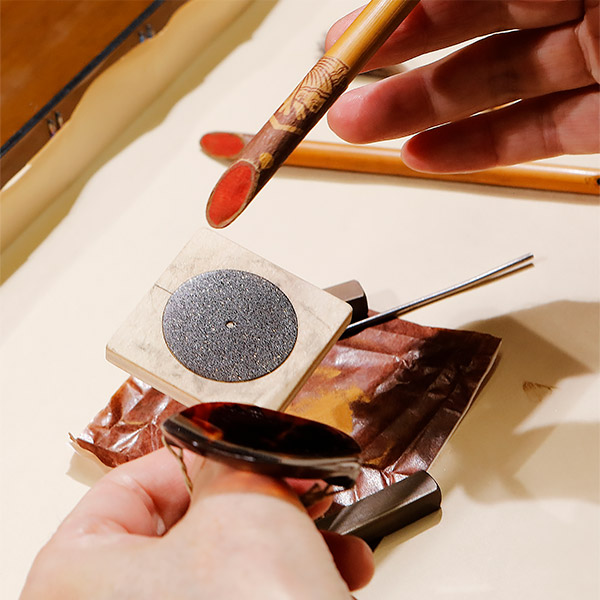 Several pictures illustrating the age-old Japanese art of Urushi lacquer in crafting the new L.U.C XP Urushi watch's dial. 2
