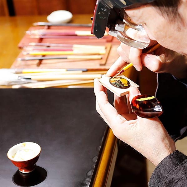 Several pictures illustrating the age-old Japanese art of Urushi lacquer in crafting the new L.U.C XP Urushi watch's dial. 3