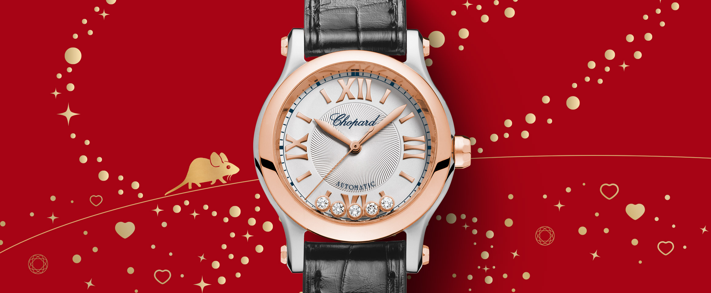 The rose gold L.U.C XP Urushi Year of the Rat timepiece over a red background with golden hearts and a tiny golden rat.