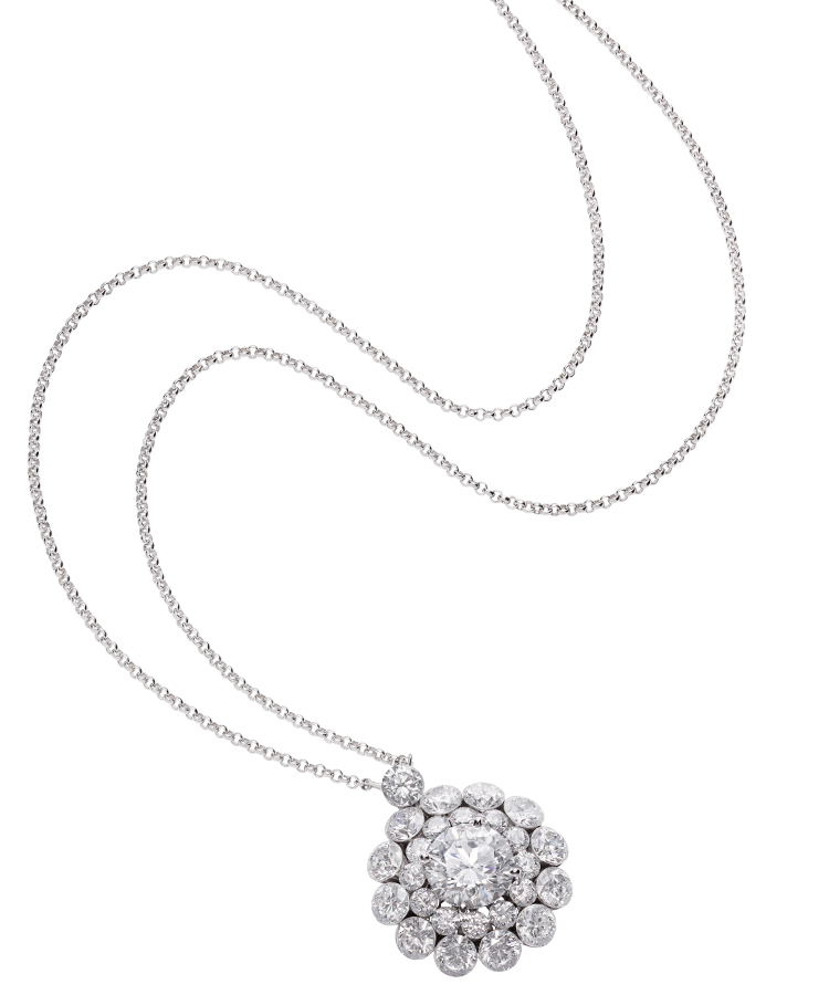 Close-up image of white gold and diamond pendant from the Magical setting collection
