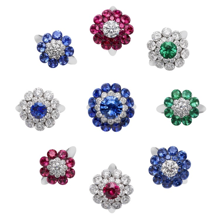 Close-up image of 9 rings featuring diamonds and colored stones from the magical setting collection