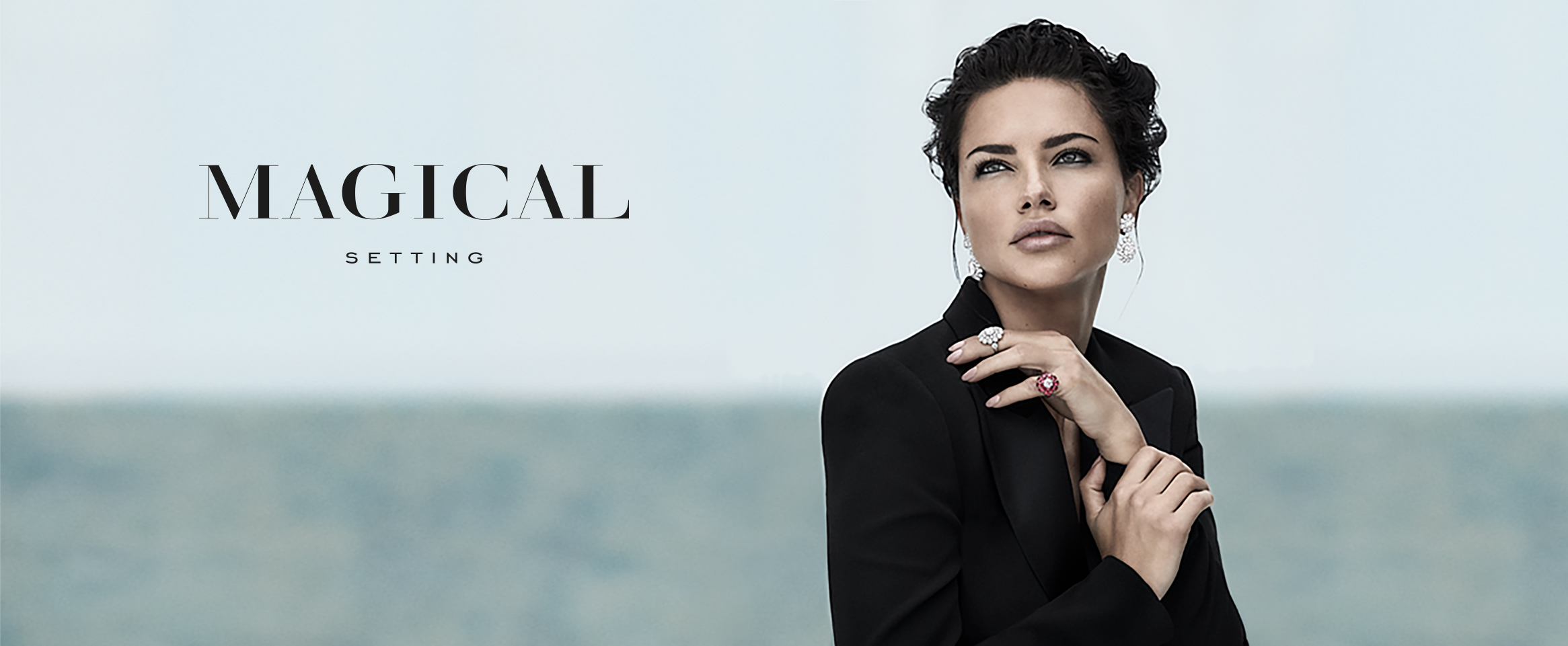 image of Model Adriana Lima wearing the new Jewelry collection earrings and 2 rings