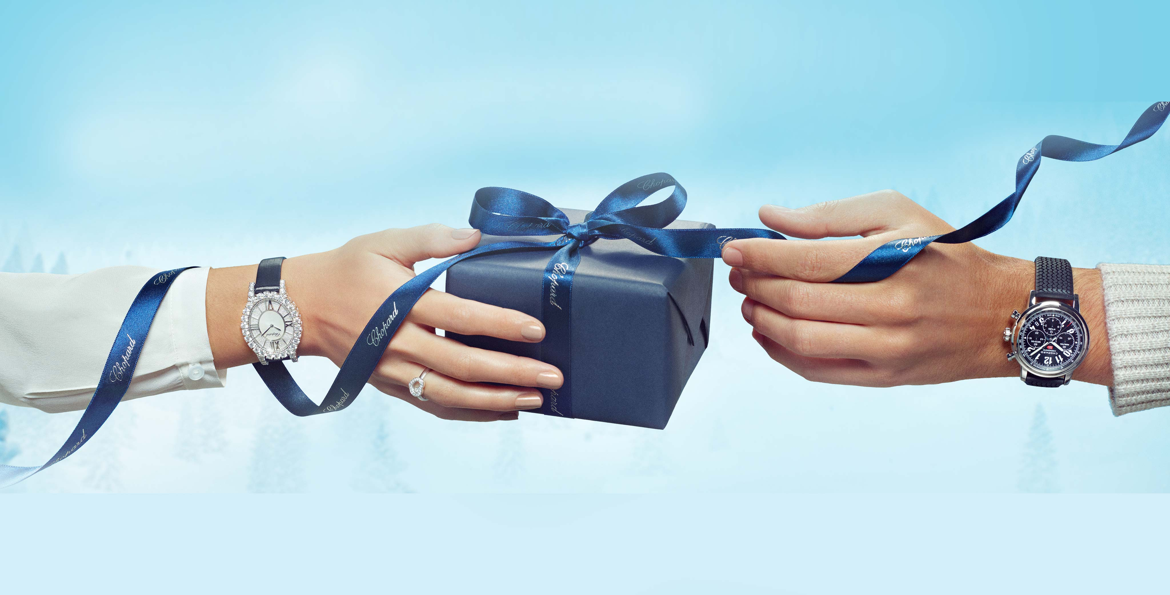 Chopard gift held by a woman's hand and a man's hand